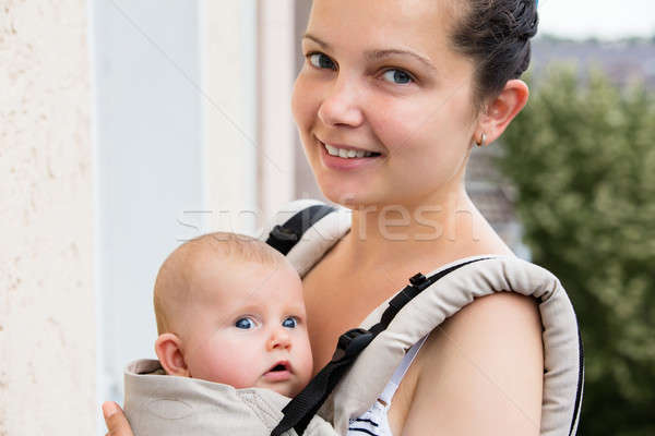 Smiling Mother With Her Baby Stock photo © AndreyPopov
