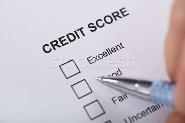 Personne remplissage crédit score forme Photo stock © AndreyPopov