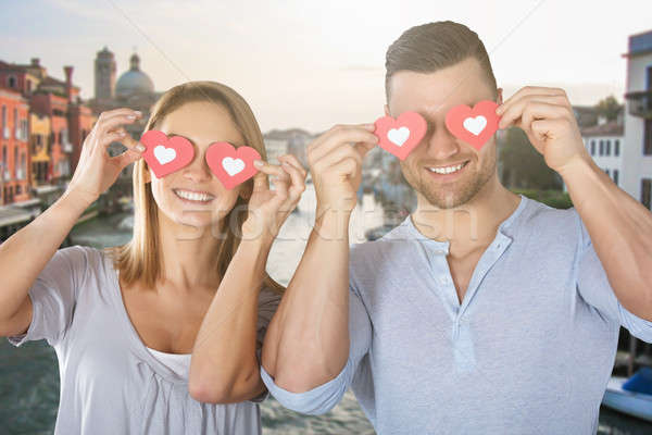 Couple Covering Their Eyes With Paper Heart Stock photo © AndreyPopov
