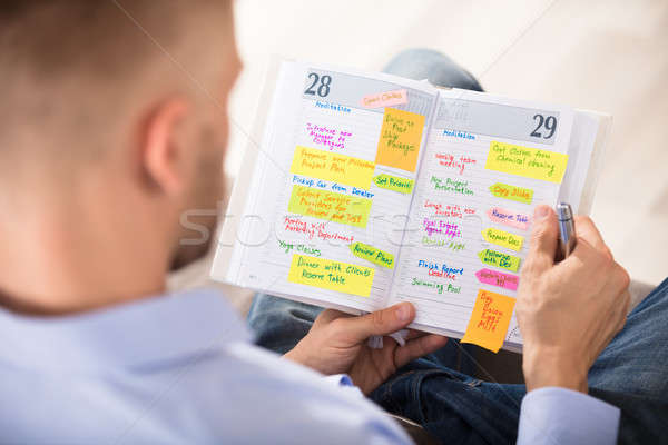 Man Writing Important Notes In Diary Stock photo © AndreyPopov