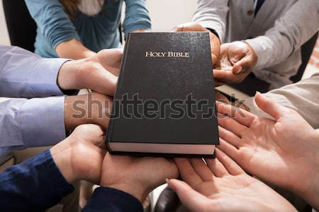 Hands Holding Holy Bible Stock photo © AndreyPopov