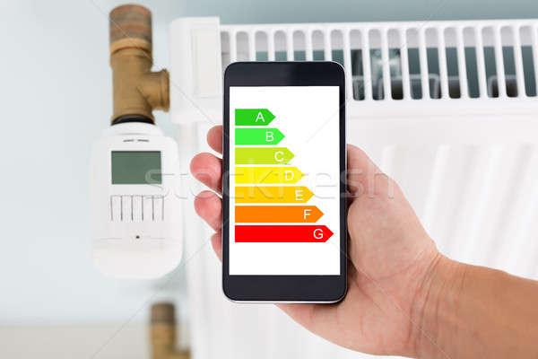 Kéz energia címke mobiltelefon radiátor közelkép Stock fotó © AndreyPopov
