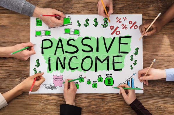Group Of People Drawing Passive Income Concept Stock photo © AndreyPopov