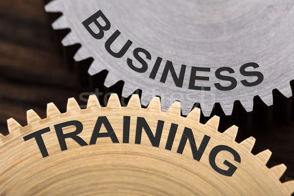 Business Training Concept On Interlocked Cogwheels Stock photo © AndreyPopov