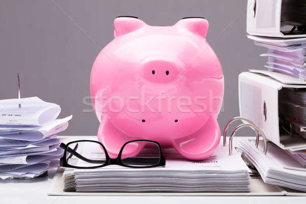 Upside Down Pink Piggy Bank On Documents Stock photo © AndreyPopov