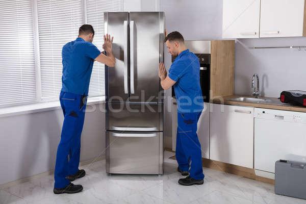 Iki buzdolabı mutfak genç erkek çelik Stok fotoğraf © AndreyPopov
