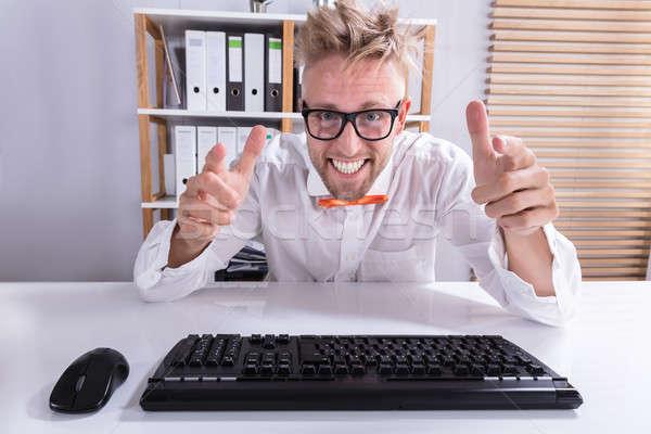 Billentyűzet mutat üzletember közelkép boldog visel Stock fotó © AndreyPopov