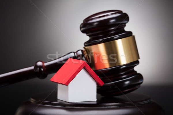 Gavel And House Model On Sounding Block Stock photo © AndreyPopov