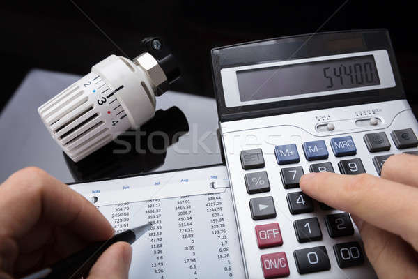 Close-up Of A Human Hand Calculating Financial Report Stock photo © AndreyPopov