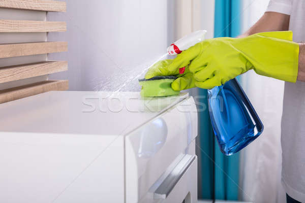 Person Cleaning Furniture With Spray Bottle Stock photo © AndreyPopov