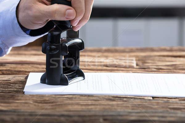 üzletember elismert bélyeg irat közelkép kéz Stock fotó © AndreyPopov