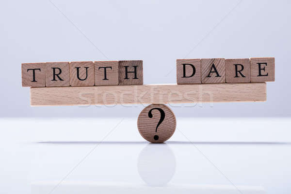 Truth And Dare Blocks Are Balanced On The Seesaw Stock photo © AndreyPopov