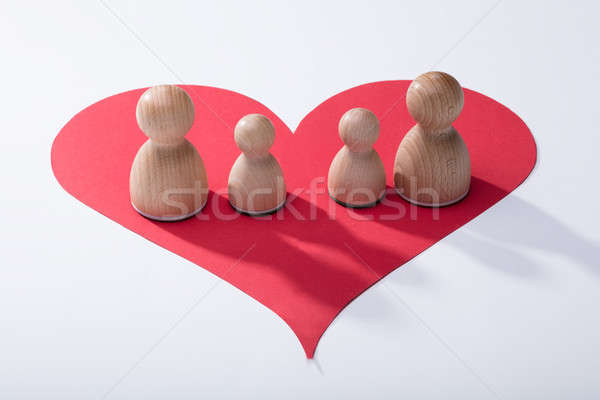 Wooden Pawns On Red Heart Shape Stock photo © AndreyPopov