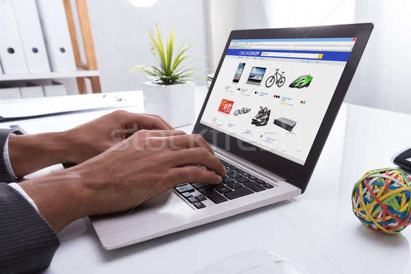 Businessperson Doing Online Shopping On Laptop Stock photo © AndreyPopov