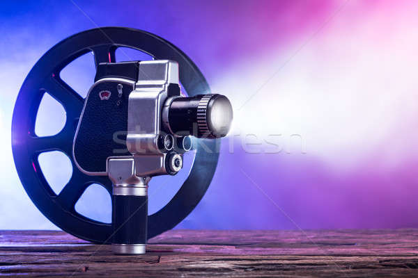 An Illuminated Movie Camera And Film Reel Stock photo © AndreyPopov