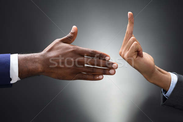 Businesspeople Showing Fuck Off Sign To The Person Shaking Hand Stock photo © AndreyPopov