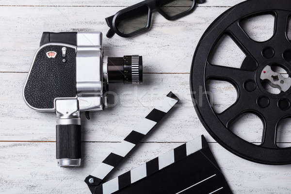 Elevated View Of Movie Camera, Film Reel And Clapper Board Stock photo © AndreyPopov