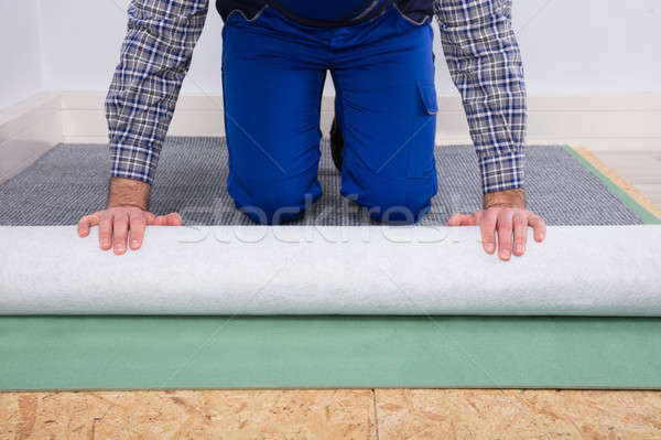 Close-up Of A Worker Installing Carpet Stock photo © AndreyPopov