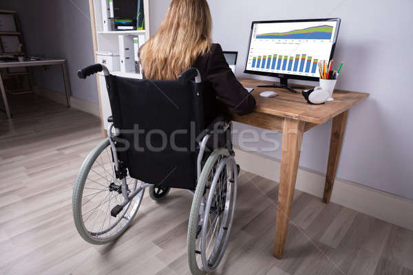 Disabled Businesswoman Working On Computer Stock photo © AndreyPopov
