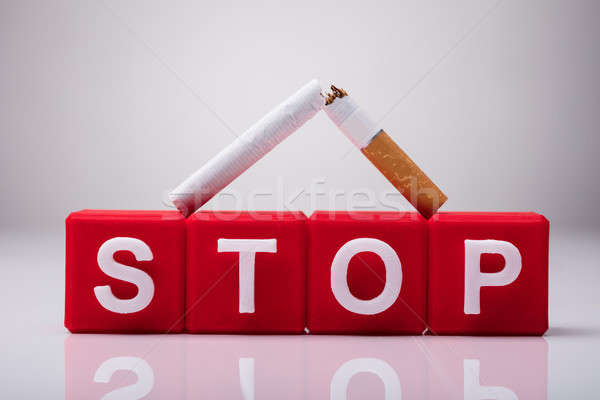 Stop Cubic Blocks Surrounded By Broken Cigarettes Stock photo © AndreyPopov