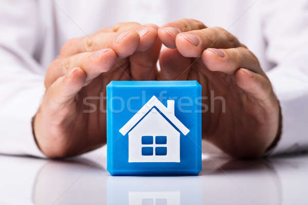 Human Hand Protecting Cubic Block With Home Icon Stock photo © AndreyPopov