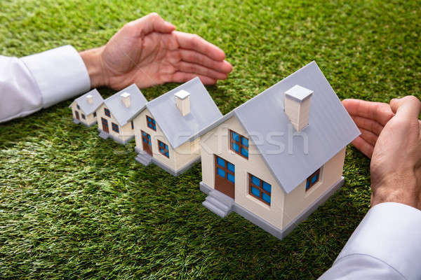 Person Protecting Increasing Houses Stock photo © AndreyPopov