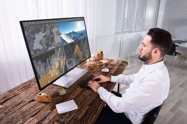 Man Editing 3D Landscape On Computer Stock photo © AndreyPopov
