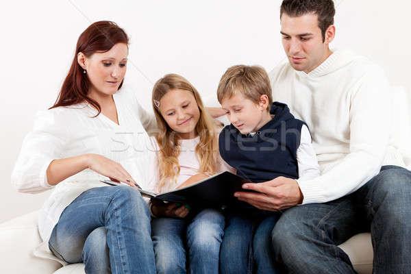 Fiatal család néz fényképalbum otthon lány Stock fotó © AndreyPopov