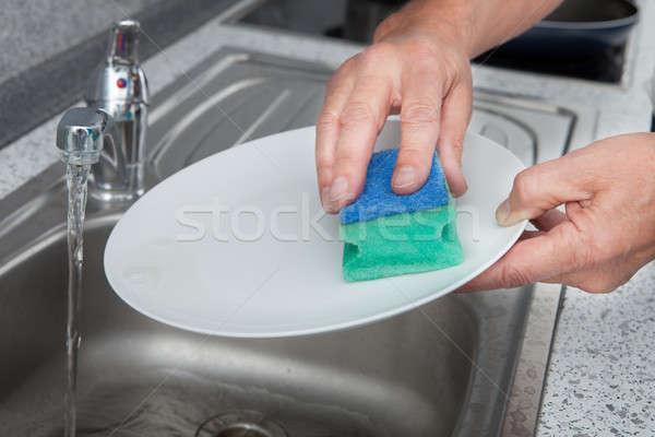 Yıkama plaka el temizlik su Stok fotoğraf © AndreyPopov
