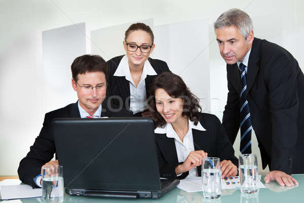 Smiling successful business team Stock photo © AndreyPopov