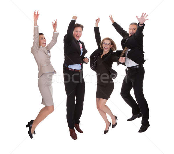 Four business partners jumping for joy Stock photo © AndreyPopov