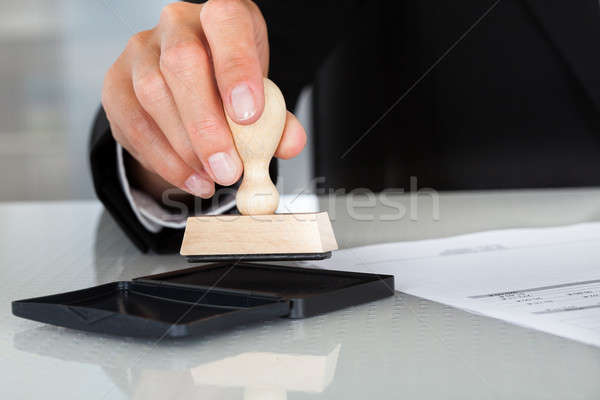 Business Man Hand With Rubber Stamp Stock photo © AndreyPopov