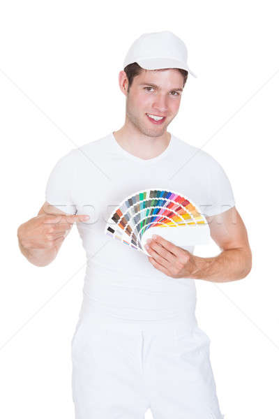 Young Man Holding Color Palette Stock photo © AndreyPopov