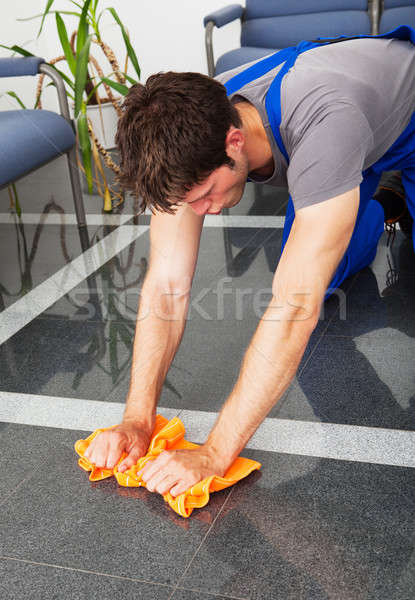 Man Cleaning With Duster Stock photo © AndreyPopov