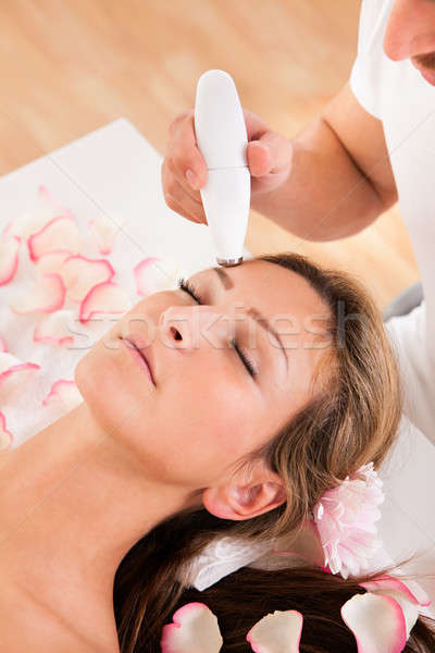 Attractive woman undergoes facial treatment Stock photo © AndreyPopov