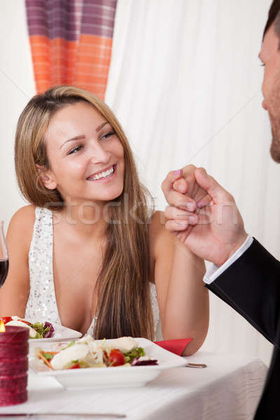 Man holding a woman's hand at a romantic dinner Stock photo © AndreyPopov