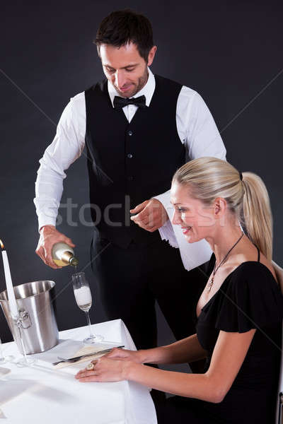 Waiter serving champagne Stock photo © AndreyPopov