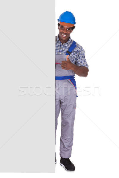 Male Craftsman With Blank Card Stock photo © AndreyPopov