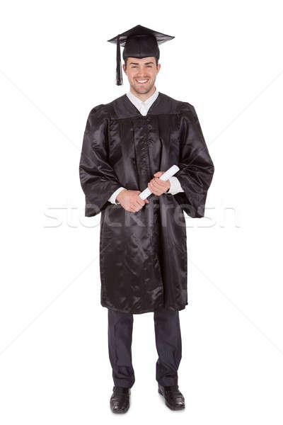 Jeunes graduation homme isolé blanche Photo stock © AndreyPopov