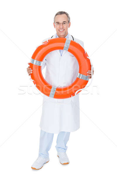 Stock photo: Happy Male Doctor Holding Rescue Ring