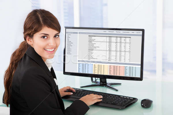Confident Businesswoman Using Computer At Desk Stock photo © AndreyPopov