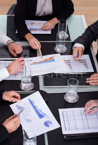 Group Of Businesspeople Discussing Plan In Office Stock photo © AndreyPopov