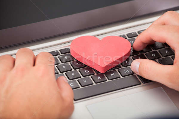 Man Dating Online On Laptop Stock photo © AndreyPopov