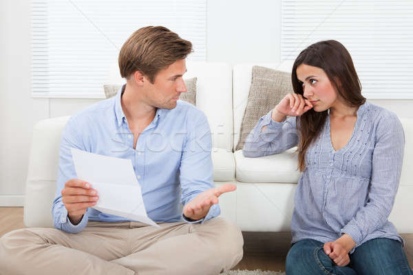 Couple Discussing Over Document At Home Stock photo © AndreyPopov