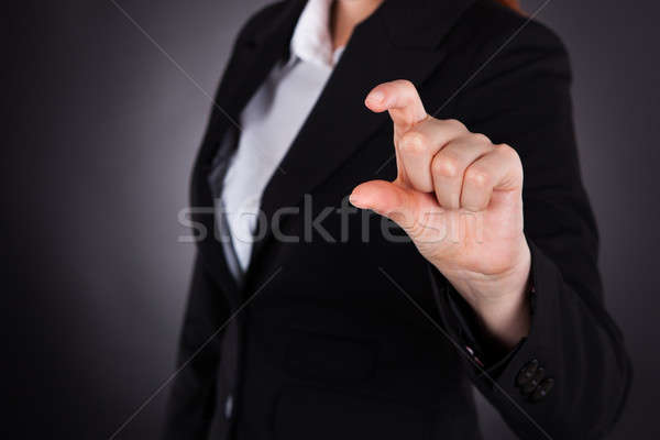 Businesswoman Showing Small Amount Gesture Stock photo © AndreyPopov