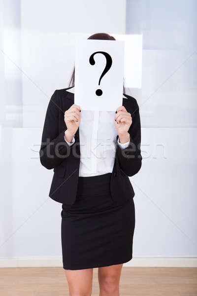 Businesswoman Holding Question Mark Sign Stock photo © AndreyPopov