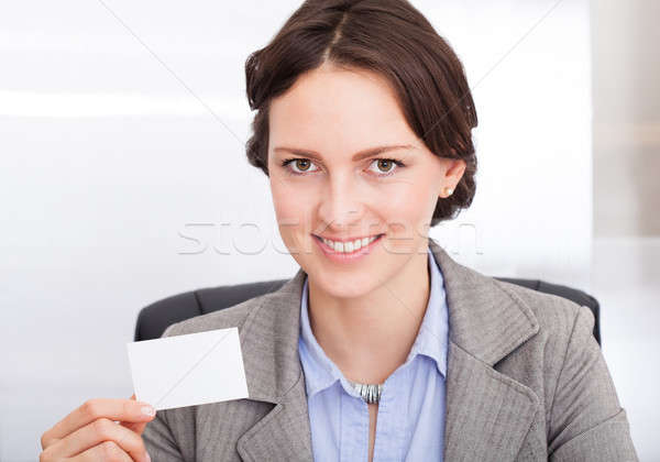 Businesswoman Holding Visiting Card Stock photo © AndreyPopov