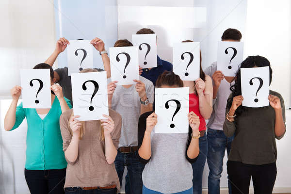 University Students Holding Question Mark Signs Stock photo © AndreyPopov