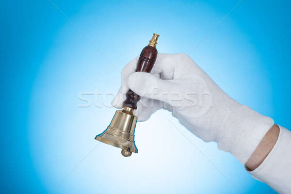 Butler Holding Call bell Stock photo © AndreyPopov