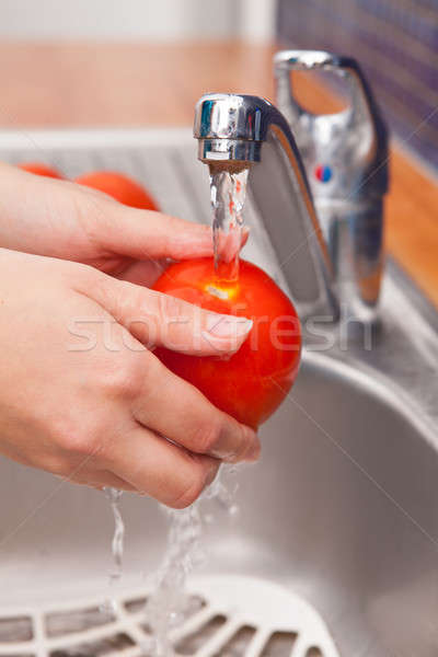 Woman Washing Tomato In Running Water Under Tap Stock photo © AndreyPopov
